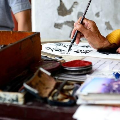Glückssprüche mit alter chinesischer Handschrift.