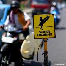 Surfer crossing.